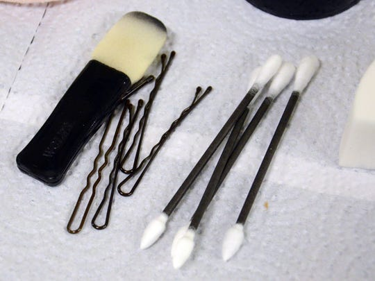 Some of the makeup and tools used by Ray Asiala and Alan Ostrander of AEO Studios to apply makeup and hair to Christina LaFortune. They are designing the characters for this year's Trail of Terror at Brevard Zoo.
