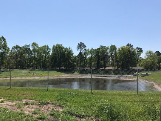 A retention pond at Rochelle was constructed to help drain areas east of a railroad track.