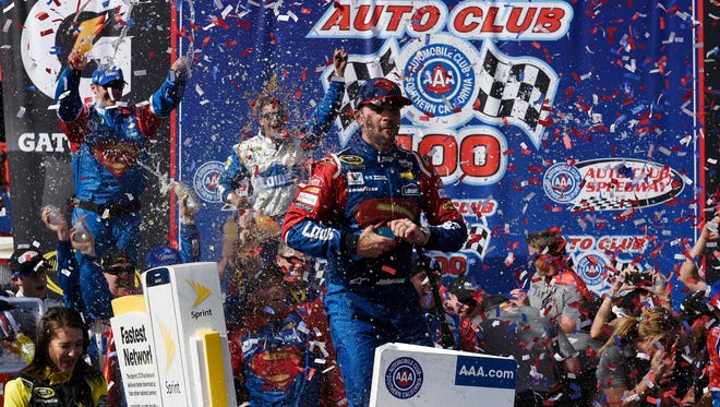 Mar 20, 2016; Fontana, CA, USA; Sprint Cup Series driver Jimmie Johnson (48) celebrates his win at the Auto Club 400 at Auto Club Speedway.