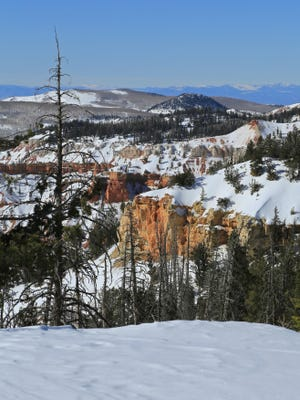Snowshoeing in Cedar Breaks National Monument allows visitors to view the red rock amphitheater under a blanket of snow.