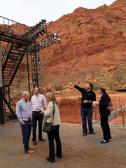 Tuacahn employee Brad Shelton, second from right, takes local dignitaries on a tour backstage at the amphitheater Friday in Ivins City.