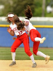 Rancocas Valley's centerfielder Shana Nuss collides with shortstop Zoe Rodriguez while fielding a popup in the Hammonton Invitational championship game at Hammonton High School. April 30th 2017