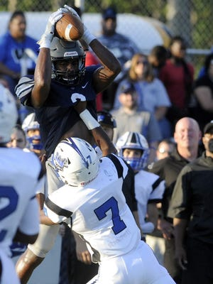 St. Augustine's Xavier File catches a pass during a victory over Williamstown last Friday.