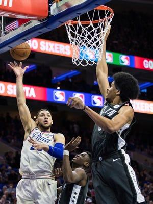 Philadelphia 76ers guard Ben Simmons shoots as Brooklyn Nets' Caris LeVert, center, and Jarrett Allen, right, defend Tuesday, April 3, 2018 in Philadelphia.