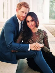 Prince Harry posing with his fiancee, Meghan Markle,