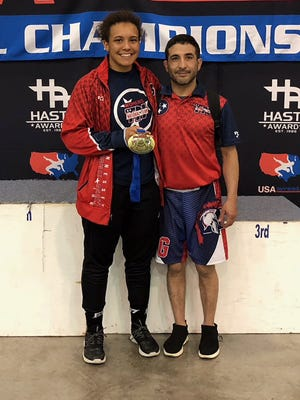 Kenya Sloan with her Amateur Athletic Union (AAU) coach Junior Hernandez at the USA Wrestling Championships in Oklahoma, Saturday, March 24.