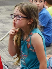 Ginny Burgener, 6, asks for quiet before the show.
