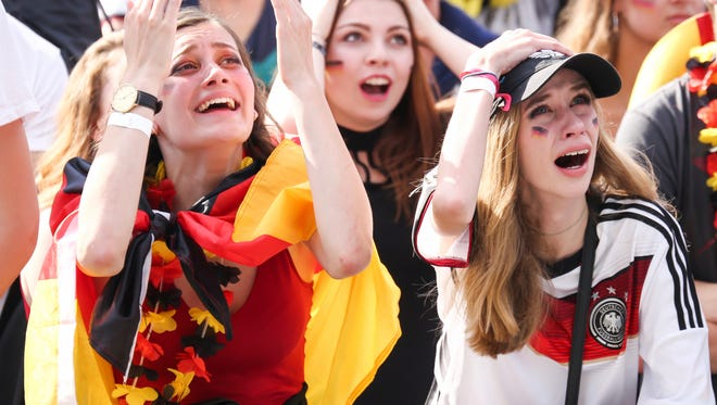 Fans react after Germany was eliminated from the World Cup as they watch in Hamburg.