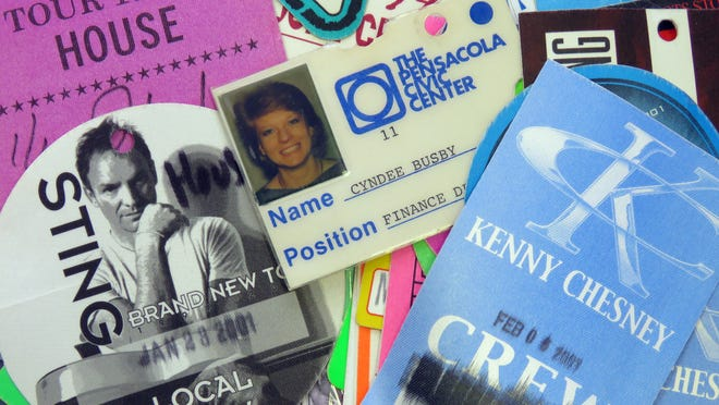 Cyndee Pennington, now General Manager of the Pensacola Bay Center, is shown, center, in one of the employee identification cards used early in her career. In the years she's been at the Pensacola Bay Center she's help book and arrange the performances of dozens of acts that have left with with piles of show passes as keepsakes in her career.