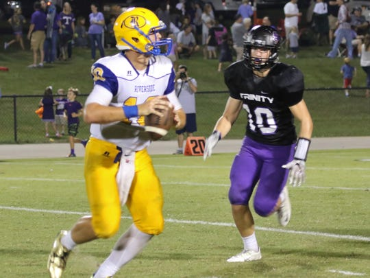 Riverside's Drake Smith looks to pass against TCA in