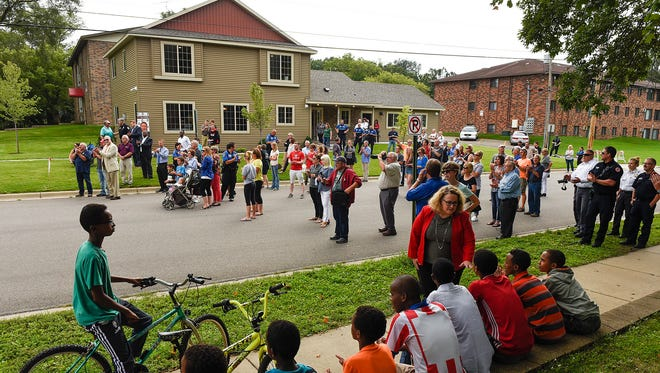 People gathered for the official opening of the St. Cloud Rotary Richard C. Wilson Community OutPost Friday, Aug. 18, near Southside Park.