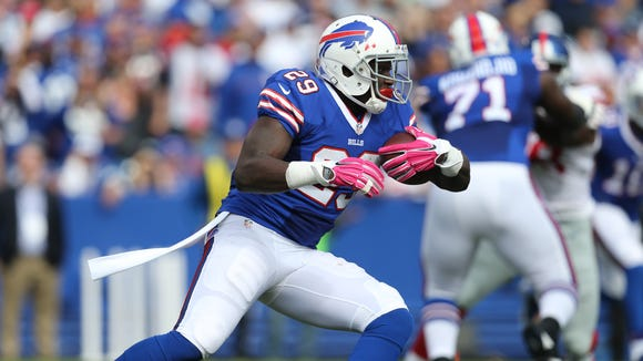 Karlos Williams carries the ball in the first half against the Giants.