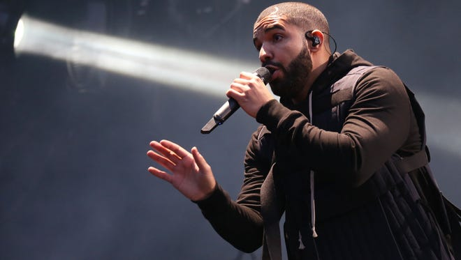 Toronto rapper Drake performs on the main stage at Wireless festival in London on July 3. His surprise 'If You're Reading This It's Too Late' is the first album to sell more than 1 million copies this year.