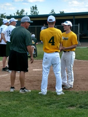 Current Howell baseball co-coach and Gold team manager Mike Weatherly stands with former players Brett Chaperon (4) and Bailey Burton (right) at Saturday's 8th Howell Alumni Baseball Game.