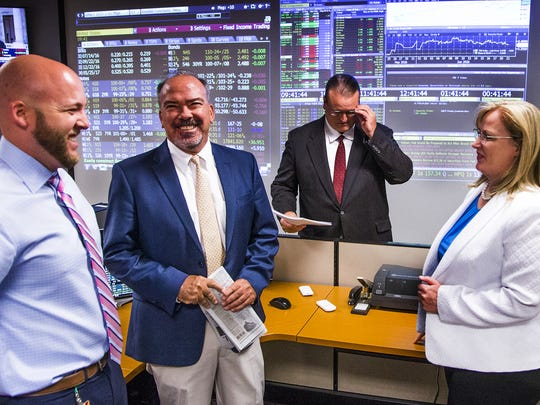 From left, investment analyst Jake Richardson, portfolio