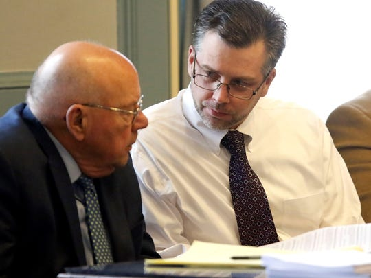 Shawn Grate converses with a defense attorney on Monday, April 23.