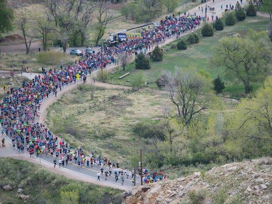 Runners begin the Horsetooth Half Marathon on Sunday, April 23, 2017.