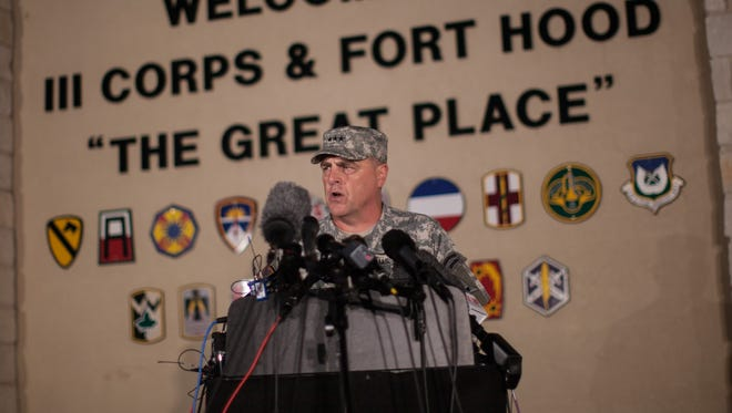 Lt. Gen. Mark Milley, commanding general of III Corps and Fort Hood, speaks with the media outside of an entrance to the Fort Hood military base following a shooting that occurred there, Wednesday.