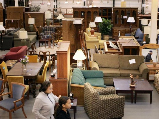 In this file photo, customers look over furniture at ReStore, the furnishings, houseware and construction supply outlet run by Habitat for Humanity.