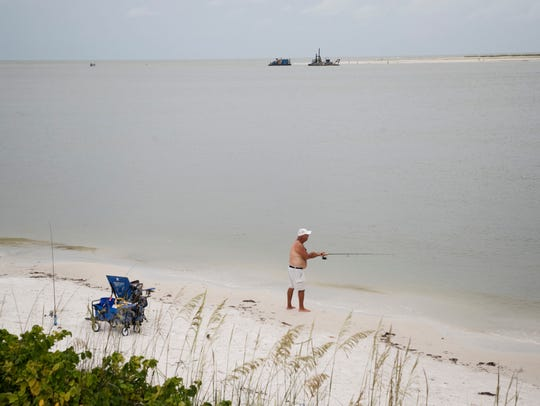 A fisherman tries his luck in Big Carlos Pass just