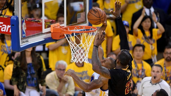Warriors greeted by poster of LeBron James\' block from NBA Finals