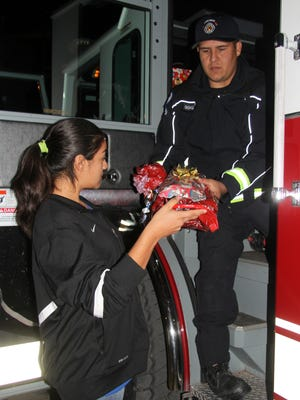 Members of the Carlsbad Police Department helped deliver the presents to Transitional Housing in one of their fire trucks.