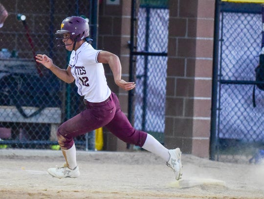 Ankeny's Jasmine Rumley (12) rounds third headed for