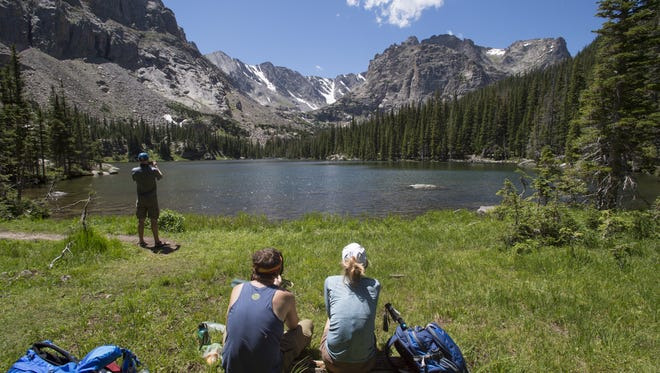 Hikers visit Loch Vale in Rocky Mountain National Park on Saturday, July 23, 2016.