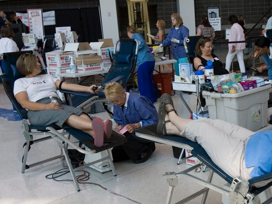 People donate blood at a United Blood Services Summer Blood Drive at the US Airways Center.