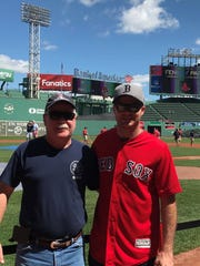 Tim Connors, left, and Quinn Connors, at the Red Sox vs. Yankees.