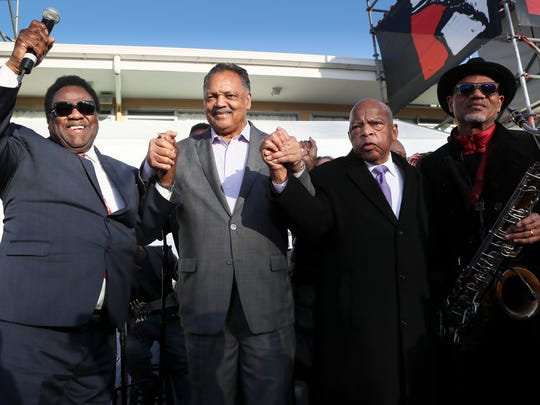 "Al Green, Rev. Jesse Jackson, Rep. John Lewis and saxophonist Kirk Whalum wave to the crowd after Al Green's rendition of ""Let's Stay Together "" at Lorraine Motel and National Civil Rights Museum during the commemoration ceremony for the 50th Anniversary of Martin Luther King Jr.'s assassination Wednesday, April 4, 2018, in Memphis, Tenn."