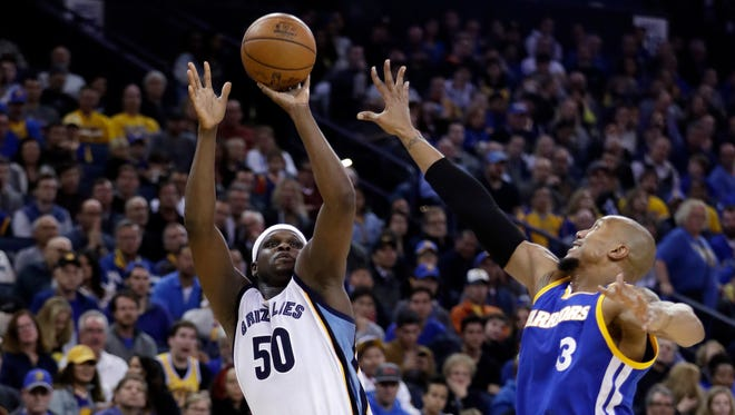 Memphis Grizzlies' Zach Randolph (50) shoots over Golden State Warriors' David West (3) during the first half of an NBA basketball game Sunday, March 26, 2017, in Oakland, Calif.