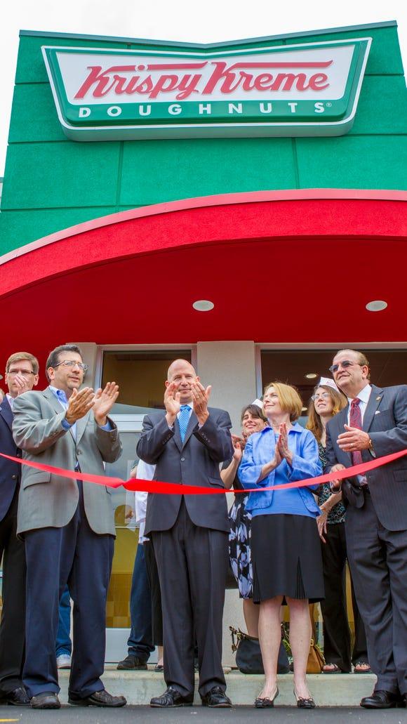 A new Krispy Kreme opens in New Castle.