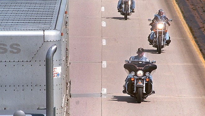 -  -Motorcyclists head west Friday afternoon on Interstate 90 near the Hartford exit toward Sturgis and the annual clas