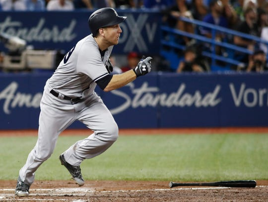 New York Yankees' Todd Frazier watches his two-run
