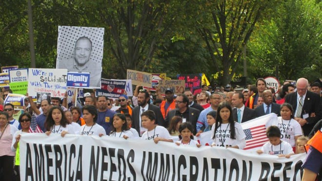 Protesters, including U.S. Rep. Raul Grijalva, D-Ariz., protest the slow movement of immigration reform in Washington.
