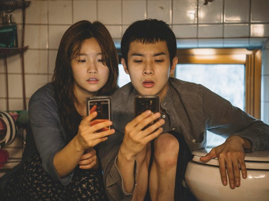 """Park So-dam, left, and Choi Woo-sik in """"Parasite."""""""