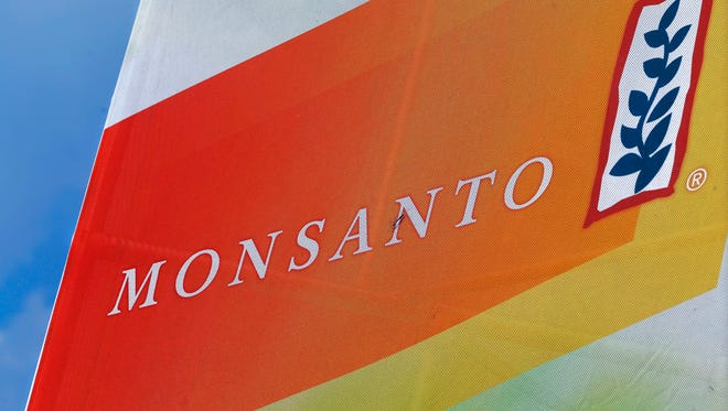 In this Monday, Aug. 31, 2015 file photo, the Monsanto logo is seen at the Farm Progress Show in Decatur, Ill. German drug and chemicals company Bayer AG confirmed Thursday, May 19, 2016 it has entered talks with the Monsanto Company about the possible acquisition of the U.S.-based specialist in genetically modified crop seeds.