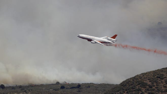 The DC10 drops flame retardant over the fire from the Hills in Yarnell on June 9, 2016.