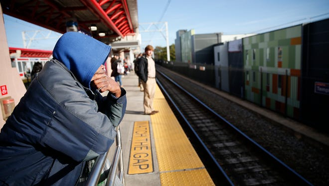 A commuter waits on the platform at Temple University station during the first day of the SEPTA strike in Philadelphia Tuesday.