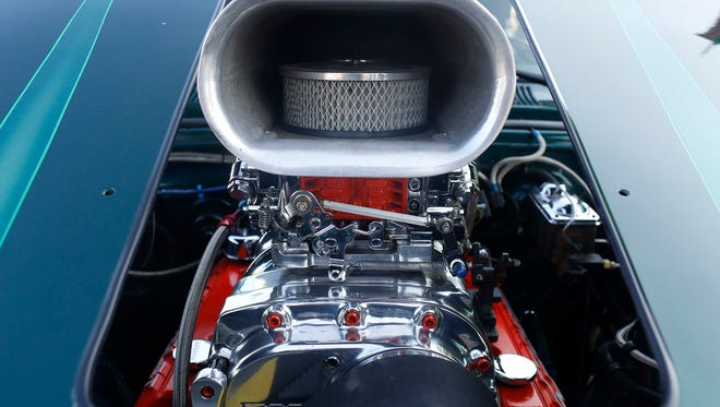 The engine of a 1966 Chevrolet II is seen through the hood while on display during the 2017 Woodward Dream Cruise on Saturday, August 19, 2017 in Royal Oak.