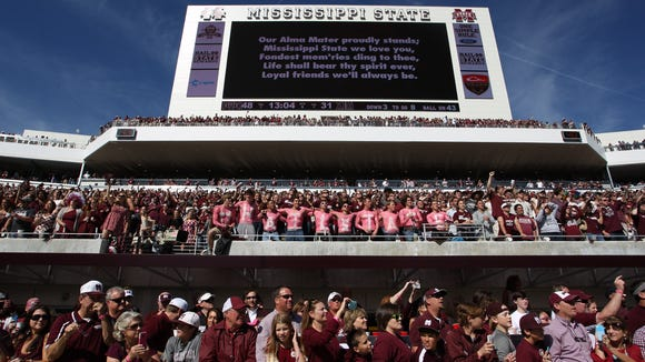 MSU fans celebrate after Mississippi State defeated Texas A&M in a college football game on Saturday, October 4, 2014 at Davis Wade Stadium in Starkville, Miss. (Photo by Keith Warren)