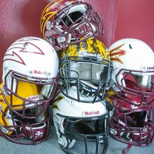 ASU football helmets are stacked up at the Carson Athletic Center next to Sun Devil Stadium in Tempe.
