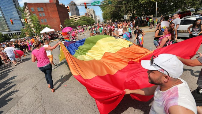 A gay pride flag takes the turn from Massachusetts Avenue to Vermont Street during the Cadillac Barbie IN Pride Parade through Downtown Indianapolis on Saturday, June 13, 2015. The parade lasted two hours.