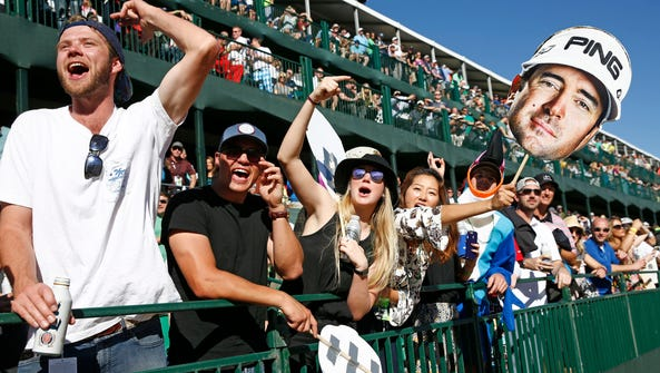 Spectators boo and cheer for Bubba Watson on the 16th