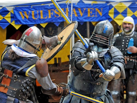 Cairell MacCormaic of Greenbelt, left, and Kenneth Kepple, or Kollack von Zveckel, of Baltimore, both of the Society for Creative Anachronisms, battle in full armor during the Chesapeake Celtic Festival, held at the Furnace Town Living Heritage Museum in Snow Hill. The 2016 festival happens Oct. 1-2.