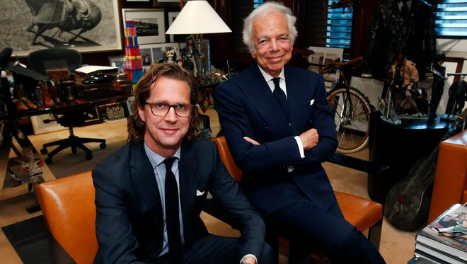 Designer Ralph Lauren, right, poses in his office with Stefan Larsson, global brand president for Old Navy, Tuesday, Sept. 29, 2015, in New York as Lauren said Larsson would succeed him as CEO.