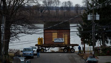 Newburgh's Little Red Brick House on the move