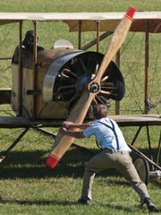 The engine of a 1914 Caudron is started during an event
