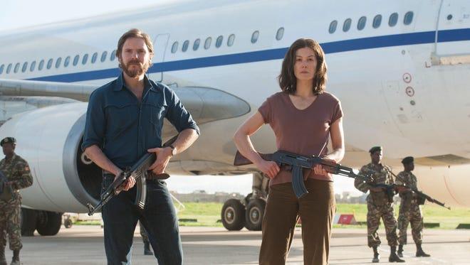 "Daniel Brühl and Rosamund Pike star in ""7 Days In Entebbe."""